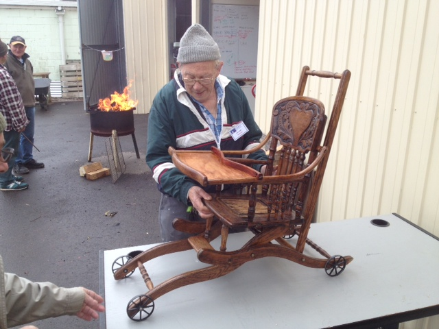 Poor aka Men's Shed participant Bill, working on restoring his family's 150-year-old child's high chair